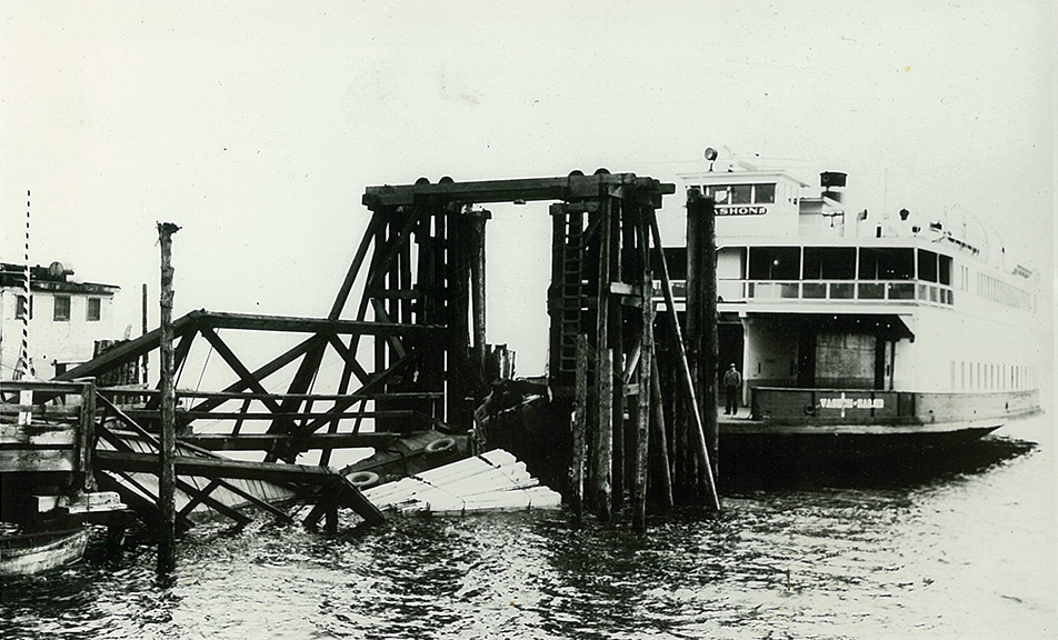 Logging truck rolled off the ferry dock. The Vashon is the ferry. About 1955.
