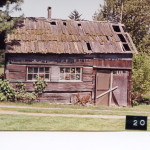 #20 Blue Gate Antiques – Clinton    Location: Cultus Bay & Goldfinch Rds. Builder: Year built: 1860s Owners: Lillian Tucker Notes: This Finnish log cabin was disassembled and rebuilt in the Freeland area.