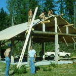 Placing boards on cedar shake roof of the picnic shelter are Don Hickson, Bill Arnold, Steve Hall and Jack Hall.