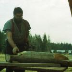 Steve Backus placing the braces on the log picnic shelter.