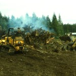 Harold Hagglund & Bob Windecker donated their equipment to clear the Community Center site and burn stumps and debris.