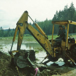 Lloyd Schumacher operating his backhoe.