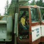 Myrna Bradley and children in dump truck.