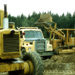 Pete Krogseng, George Paris donated their equipment with Joe Lehman operating the Bradley's road grader.