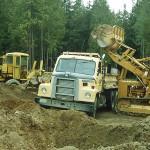 George Paris, dump truck; Pete Krogseng, bulldozer; Randy Bradley, road grader.