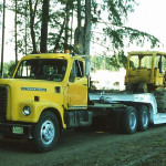 Mike Madsen delivering a bulldozer being donated by Bradley Construction.