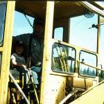 Randy Bradley and grandson Ryan on the Bradley road grader.