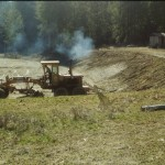 Curt Gordon operating the road grader donated by Karl Krieg.