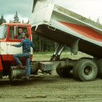 Myrna Bradley hauling pea gravel for lateral drains.