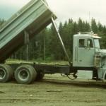 John Johansson hauling pea gravel with Curt Gordon's dump truck.