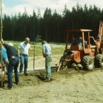 Curt Gordon, Hanford Thayer, Jim Porter, Ryan Porter, Pete Krogseng, and Bill Bergthold placing drain pipe in trenches.